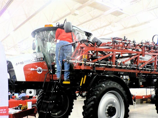 Spray rigs get  bigger and bigger. An attendee gets