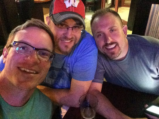 Everest Metro Police Detective Jason Weiland, right, is shown with longtime friends Eric Wetzel and Dan Rennie in 2015.