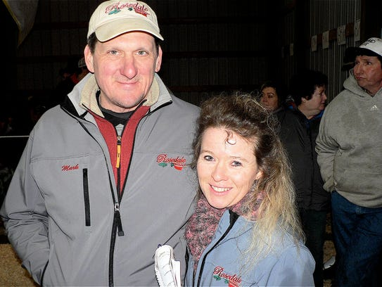 Mark and Nicky Rueth watched their Holsteins sell.