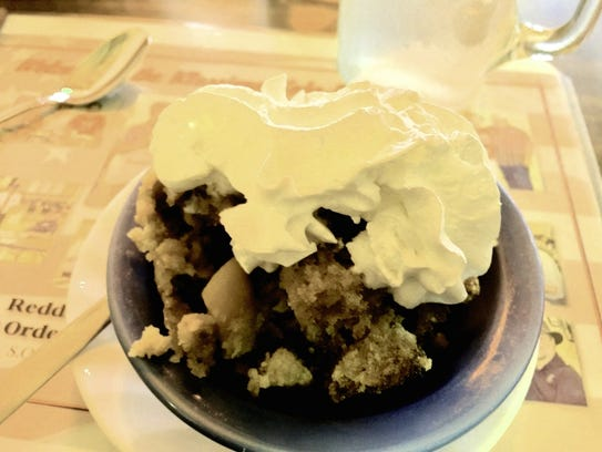 Bread pudding with whipped cream at Klassique Kafe's