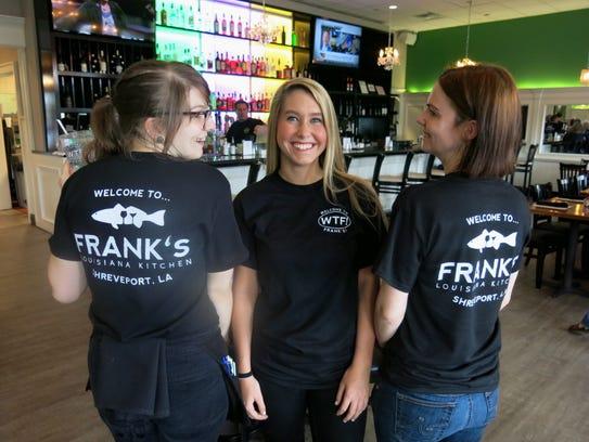 Frank's Louisiana Kitchen wait staffers showing off