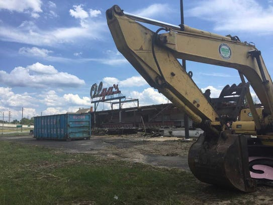 A demolition crew is razing the former Olga's Diner