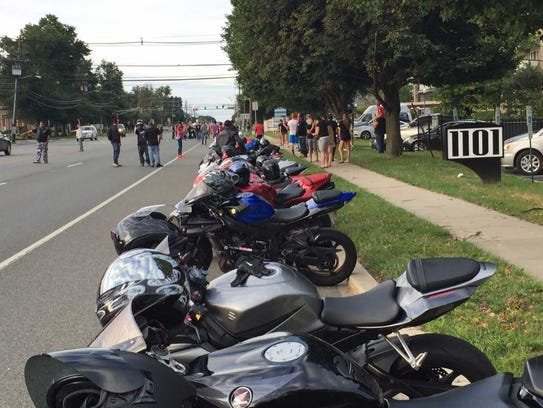 Motorcycles line a Kings Highway curb at a vigil Sunday