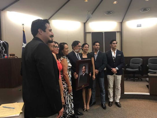 Judge J. ManuelBañales' poses with his family for