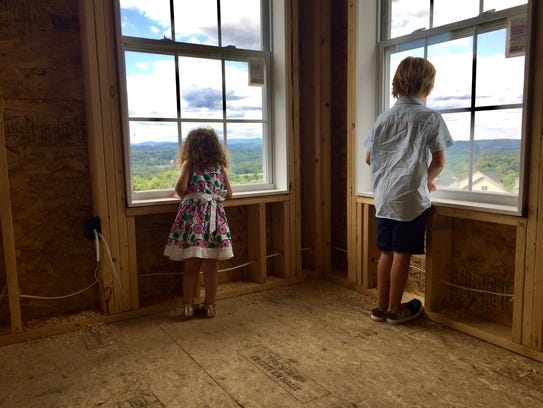 Siblings Isabella and Gavin Schumacher look out the