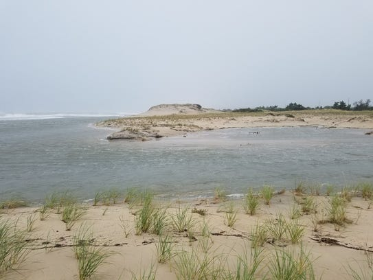 A gap in the dunes, which protect Delaware's southern