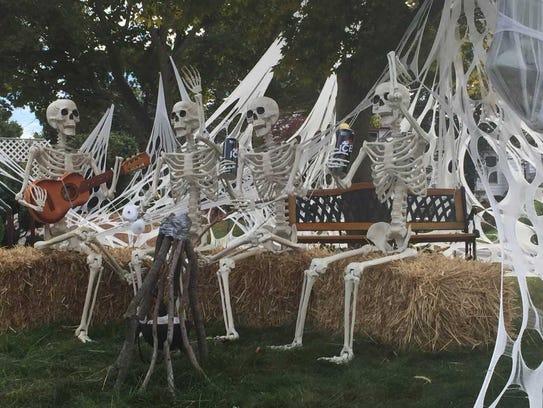 Beer-drinking, marshmallow-roasting skeletons gather