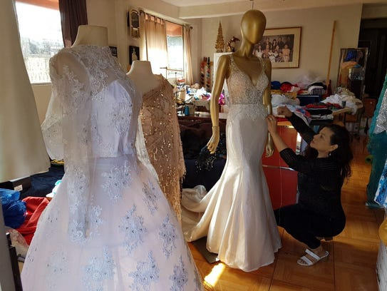 Rhodora Paloma, a local seamstress, putting the finishing