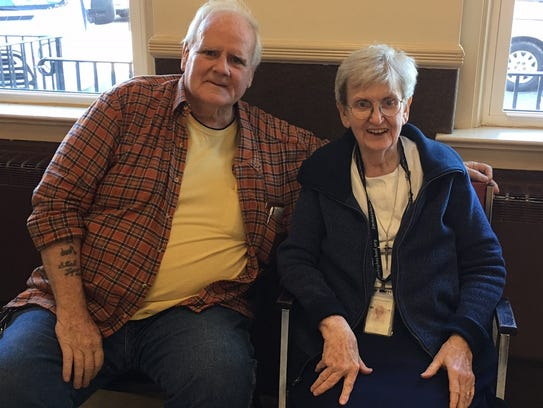 Tom O'Leary sits with Sister Karen McNeill, campus ministry at Immaculata High School at an event marking O'Leary's 40 years of sobriety.