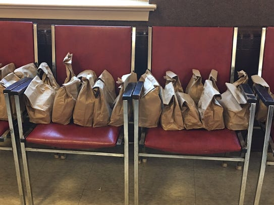 To go bags filled with additional food for the people