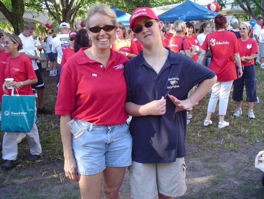 Shelly Church, left, poses with her son Kyle Fernstrom during the Collier County Heart Walk in 2004. That was the last year Kyle participated in the walk. He died in 2005 at age 18 from a heart condition.