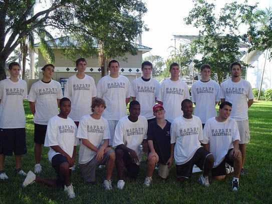 Kyle Fernstrom, wearing a black shirt, poses with his Naples High School basketball team during the 2004 Collier County Heart Walk. Fernstrom managed the team for three years. He died the following year from a congenital heart condition.