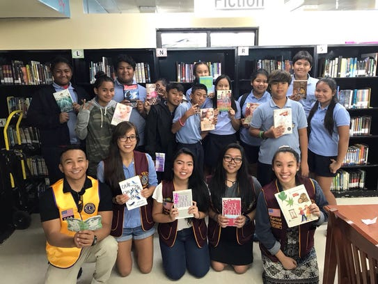 The UOG Tritons Lions Club donated more than 300 books