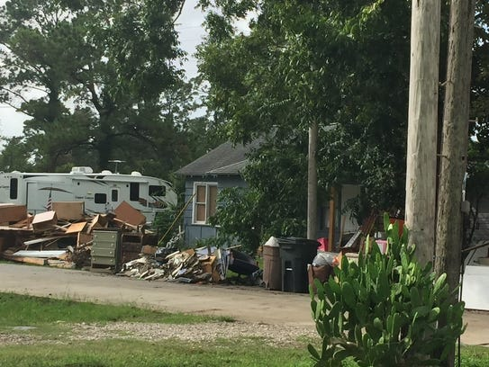 Storm debris piled by the side of the road in Beaumont,