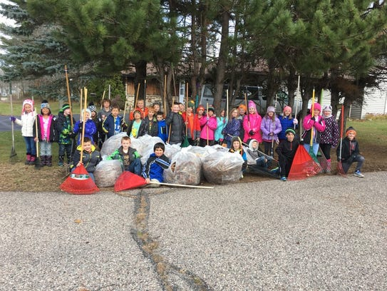 Hatley Elementary students raked leaves for some of