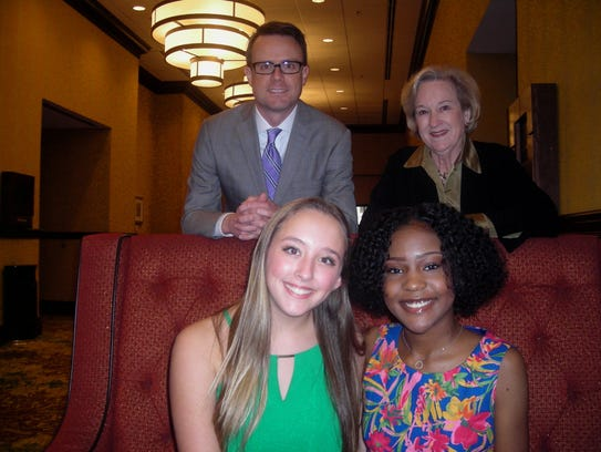 Olivia Davis (seated, right), chosen as a Prudential Spirit of Community Award Distinguished Finalist, is pictured here at Philanthropy Day in November.