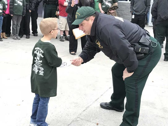 Six-year-old John shakes hands with ESCO 1st Lt. Kenneth
