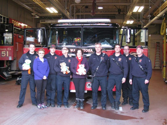 Stitches of Love Quilt Ministry from St. Matthew's Lutheran Church recently distributed 15 teddy bears to the Wauwatosa Fire Department. The bears will be given out to children in crisis situations. The fire department holds a few of the bears.