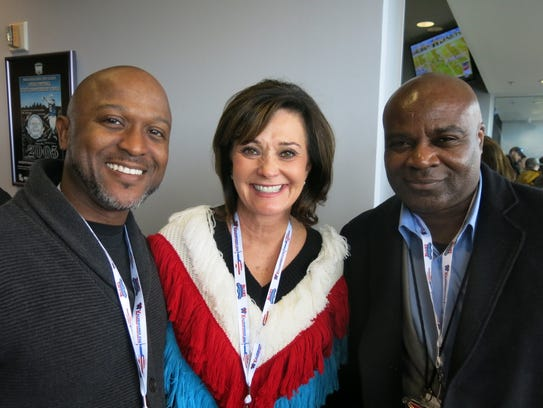 Banker Jonathan Reynolds, community leader Waynette Ballengee, Henry Thompson, head of Shreveport Regional Airport, in the mayor's  suite at Indy Bowl Party.