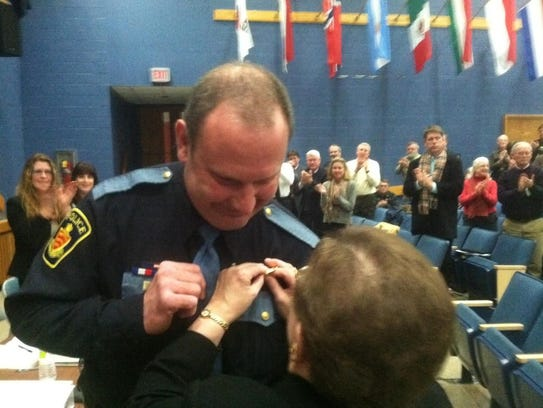 Essex Selectboard Chairwoman Linda Myers pinned the