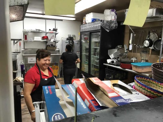 Cooks work the lunch shift at Taco Loco in downtown
