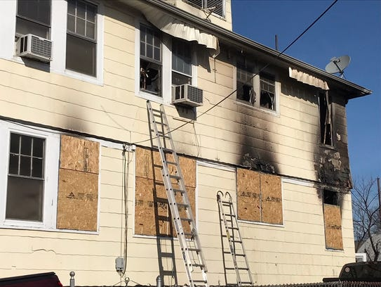 A two-alarm fire heavily damaged a Clark two-family