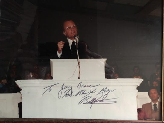 A signed photo of Rev. Billy Graham preaching in 1983