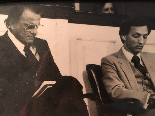 Jerry Drace sits next to Rev. Billy Graham at the first