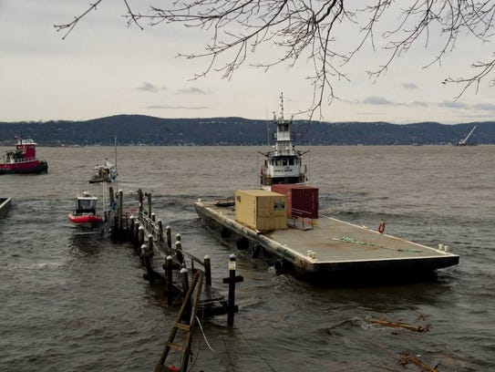 The runaway barge was towed away by a tugboat.