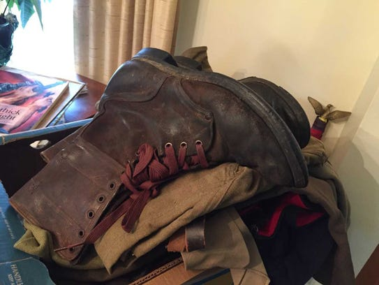 Art Lentz still has the boots he wore in combat during