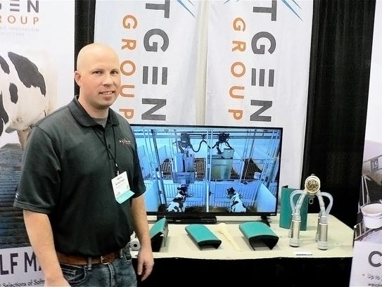 Shane Schechinger, of NextGen, shows a new automated