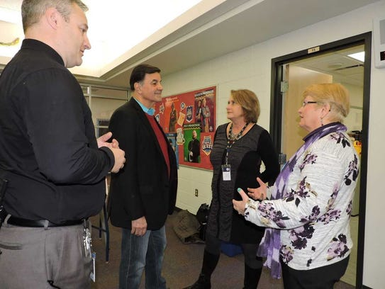 Dousman Elementary Principal Jeremy Monday (from left), retired Milwaukee sports anchor Tom Pipines, Kettle Moraine Superintendent Pat Deklotz and The Oasis Project Director Jan Frans have a discussion about the program.