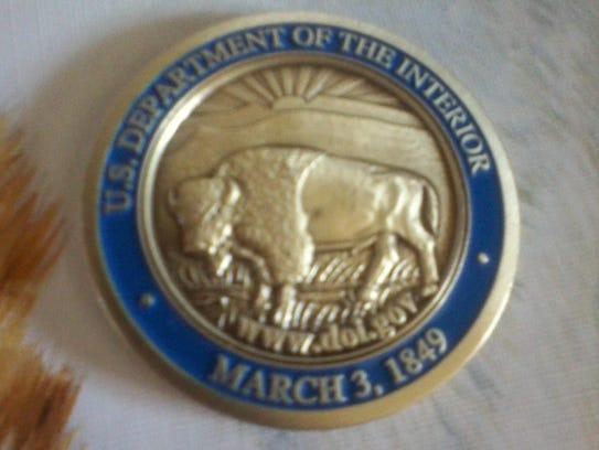 The opposite side of a medallion given to Kodak resident