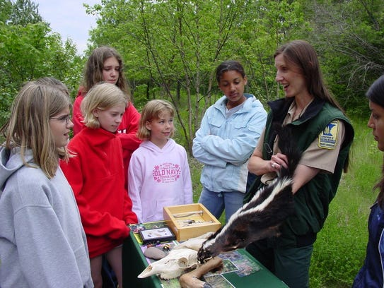 A parks naturalist runs an educational event at one
