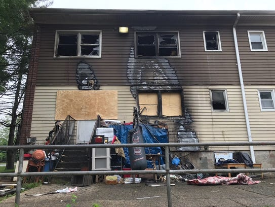 The charred rear entrance to a two-family home in North
