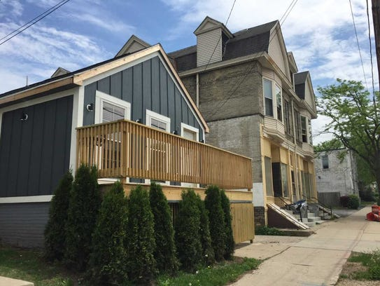 A duplex next to the former grocery also is being renovated