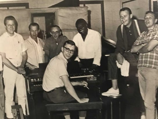 "Papa Don Schoeder, second from right, with  ""one of"