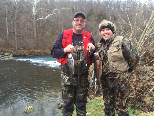 Cold rain doesn 39 t deter trout anglers on opening day at for Bennett springs trout fishing