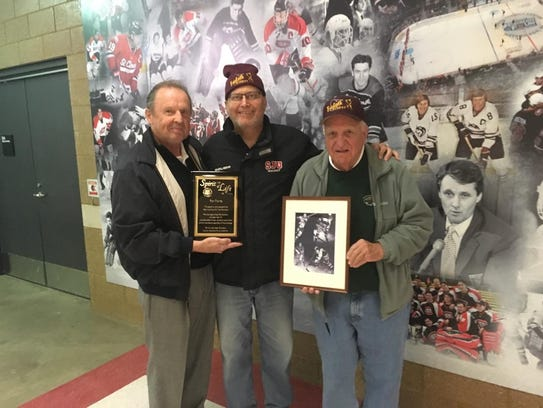 Chaz Demm of the U.S. Hockey Hall of Fame (left) and