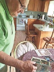 Don Anders kept a scrapbook of the people he has met at the care centers in three decades of entertaining. He made a point to shake hands with each resident.
