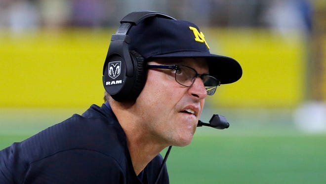 Michigan coach Jim Harbaugh watches play against Florida late in the second half of the Wolverines' 33-17 win Saturday, Sept. 2, 2017 in Arlington, Texas.