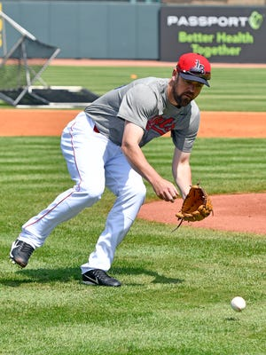 Louisville's Phil Ervin participates in fielding practice during the Bats Media Day at Louisville Slugger Field, Wednesday, April 5, 2017 in Louisville.