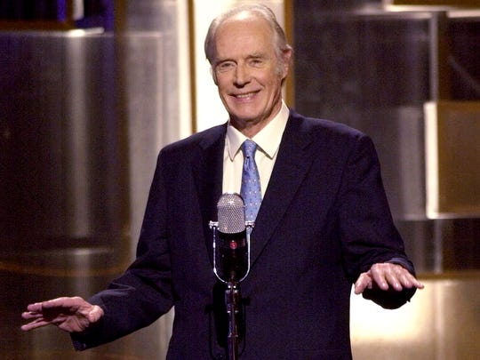 "FILE - In this March 29, 2001, file photo, Sir George Martin, the Beatles producer, makes an appearance during ""An All-Star Tribute to Brian Wilson"" concert at New York's Radio City Music Hall.  George Martin, the Beatles' urbane producer who guided, assisted and stood aside through the band's swift, historic transformation from rowdy club act to musical and cultural revolutionaries, has died, his management said Wednesday, March 9, 2016. He was 90. (AP Photo/Stephan Chernin, File)"