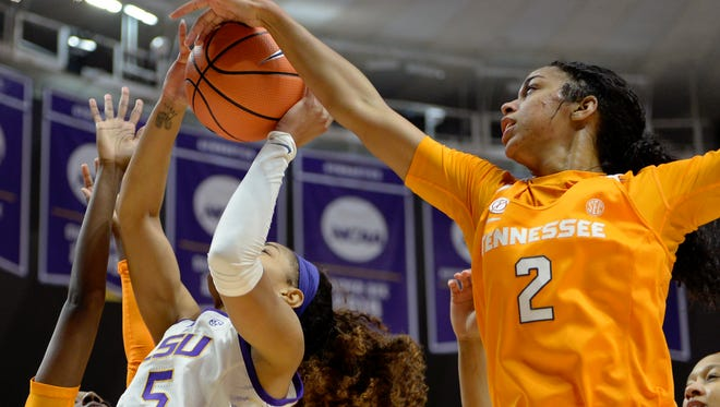 Tennessee guard Evina Westbrook (2) blocks a shot by LSU forward Ayana Mitchell (5) in the first half of an NCAA college basketball game, Sunday, Jan. 28, 2018, in Baton Rouge, La. (AP Photo/Bill Feig)