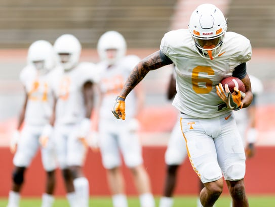 Tennessee's Alontae Taylor (6) runs down the field with the ball during practice April 7.