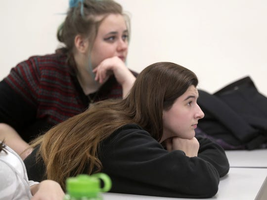 "Brianna Ulfig, right, and Kayla Belfield listens during a lecture in her first-year class ""Exploring the Jazz Loft."""