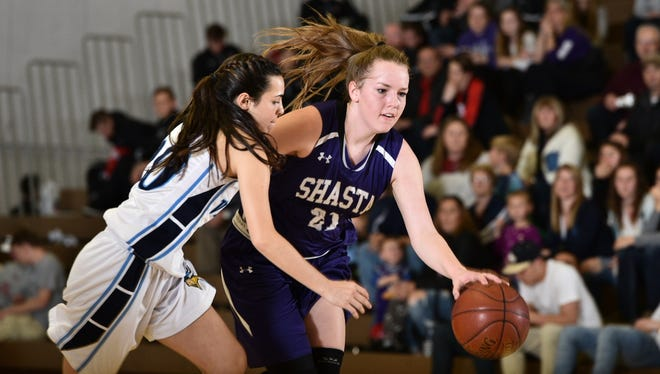 Shasta High's Cate Walton dribbles the ball past a Pleasant Valley defender during the Northern Section Division III championship Friday at Butte College. Shasta lost 56-43.