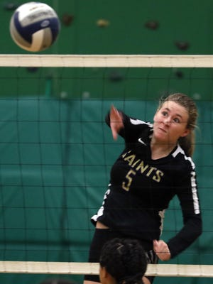 Paige O'Brien of St. Raphael Academy places a shot over the net against Central in the Division III girls volleyball semifinals in November at St. Ray's.