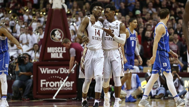 FSU's Terance Mann and Xavier Rathan-Mayes talk during a timeout against Duke during their game at the Tucker Civic Center on Tuesday, Jan. 10, 2017