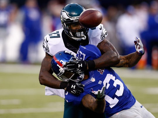 Odell Beckham (13) of the Giants tries to make a catch as Philadelphia's Malcolm Jenkins defends Sunday.